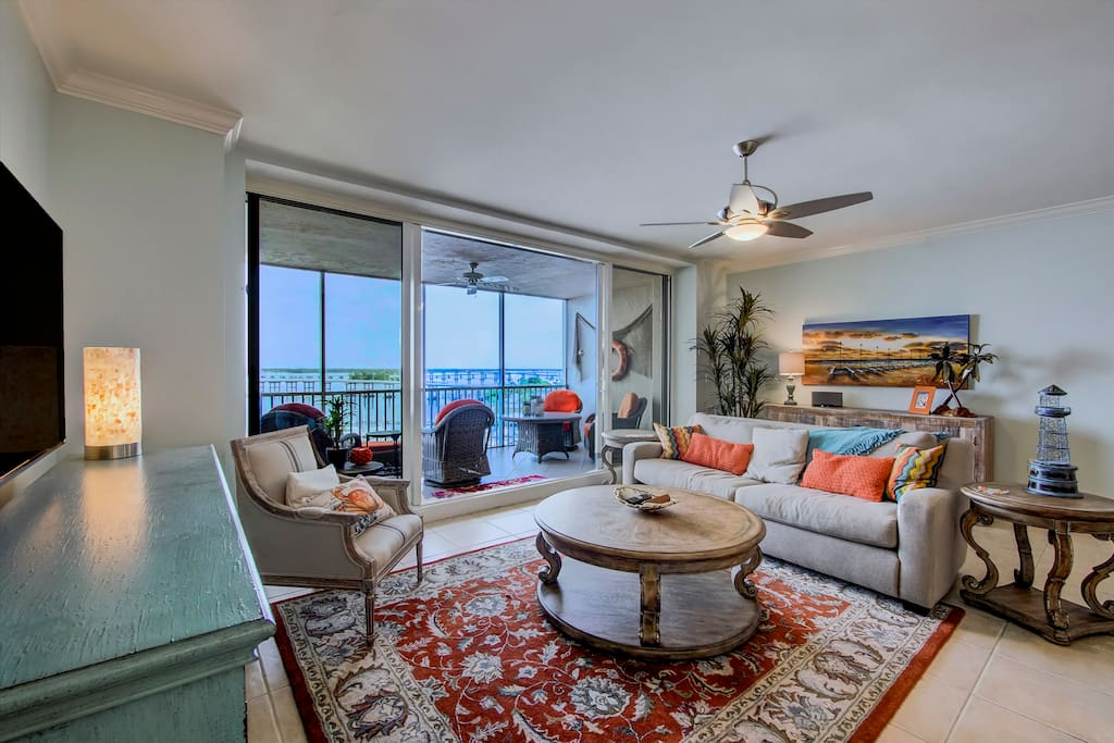 Great Room with comfortable seating and access to Main Lanai. Both sliding doors open to create outside feeling