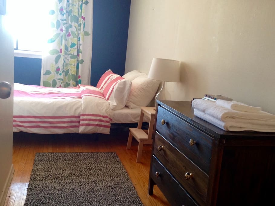 Second bedroom with double bed on the second floor.
