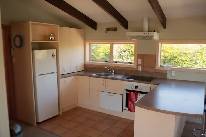 The kitchen is well lit and has nice open access to the lounge.
