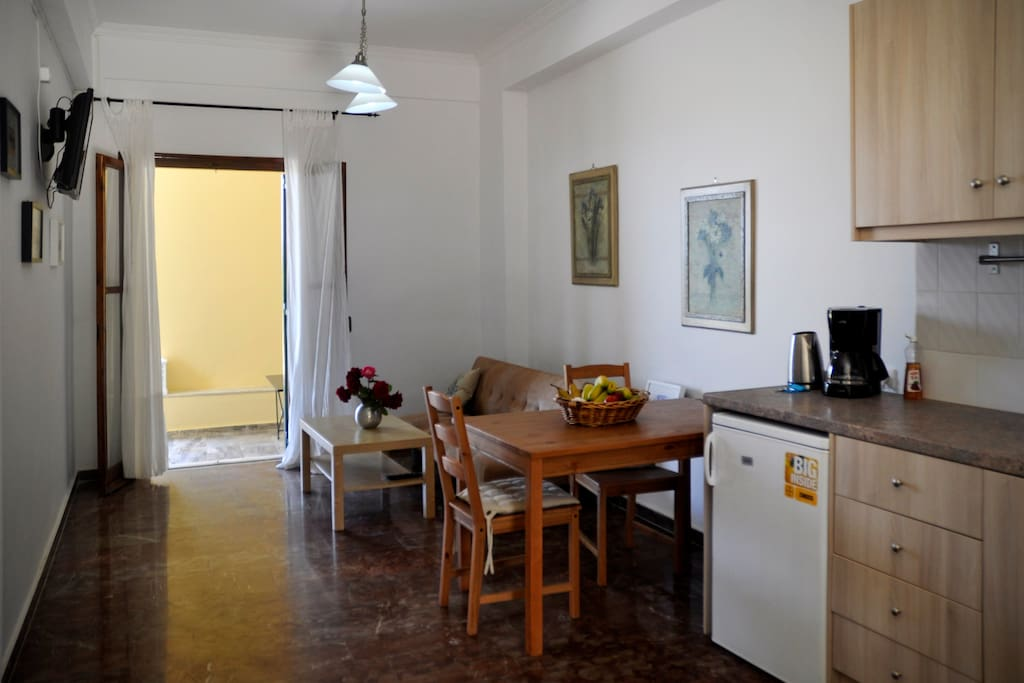 living room and kitchen, the sofa bed in the living room can accommodate 1 to 2 persons