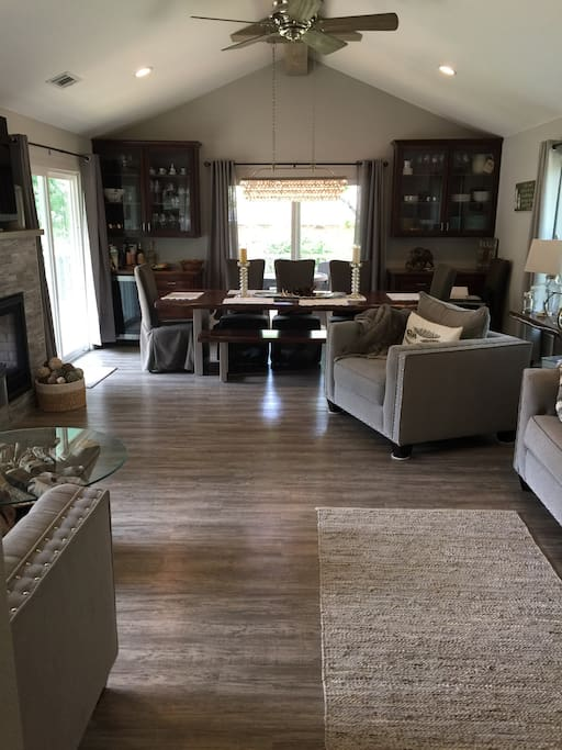 Second Living room / Formal Dining with wine fridge and large flatscreen TV.