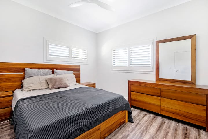 Bedroom 3 has a Queen bed, walk-through robe and private modern ensuite