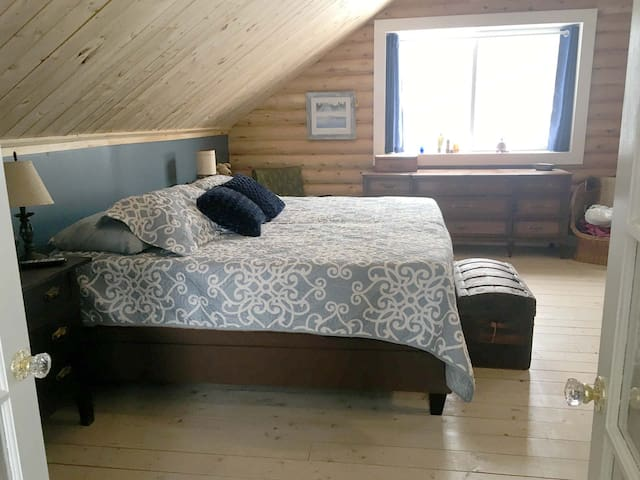 Large master suite on 2nd floor. Super King bed is posturpedic and fully adjustable head & feet, remote controlled ... it vibrates too!  (This bed can be separated into two twins if necessary).