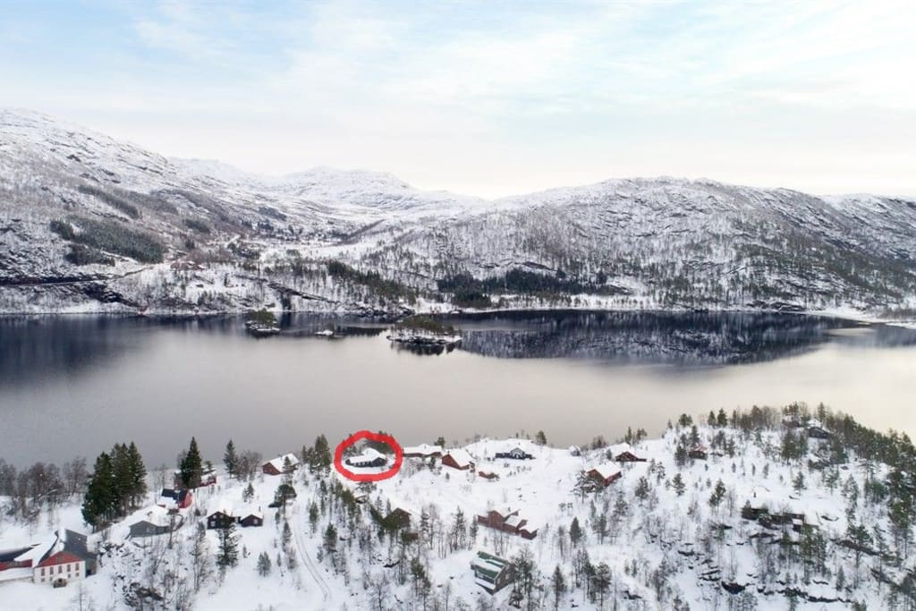 Areal view of the Eikedalsvatnet and the surrounding area. Cottage is circled in red.