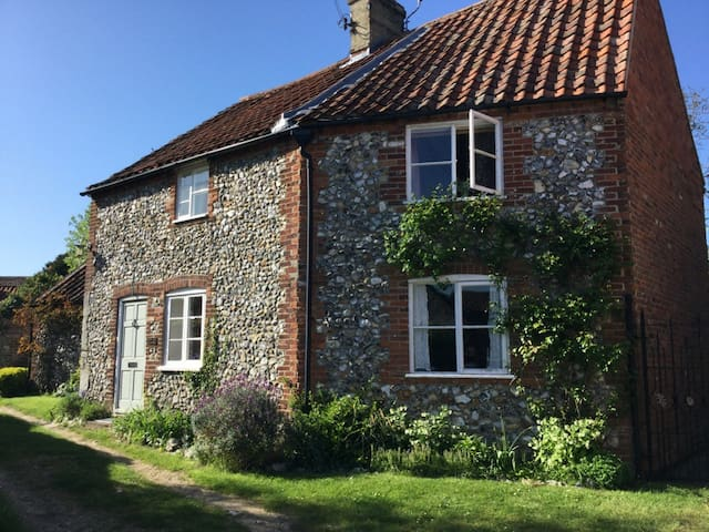 Cottage within the ancient walls of Castle acre .