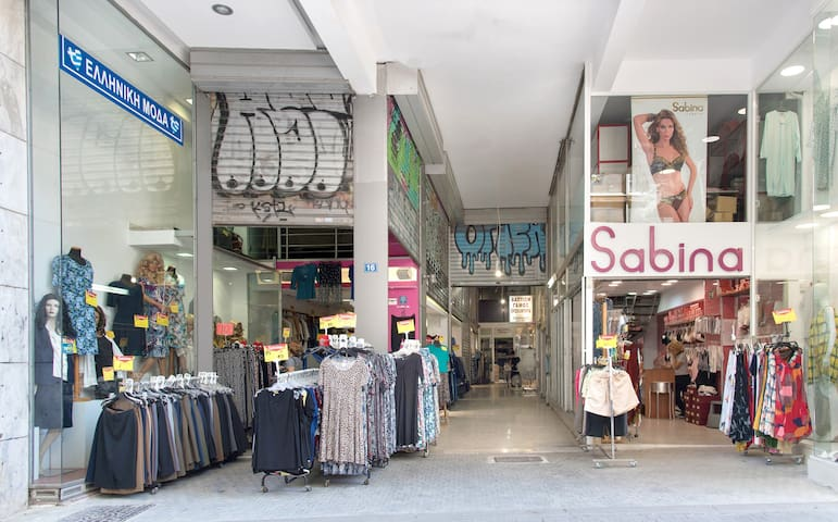 The clothing stores downstairs in our building and the building entrance corridor.