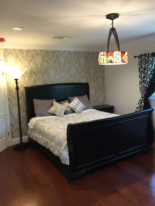 Master bedroom - King bed (new wood floor and wallpaper and paint)