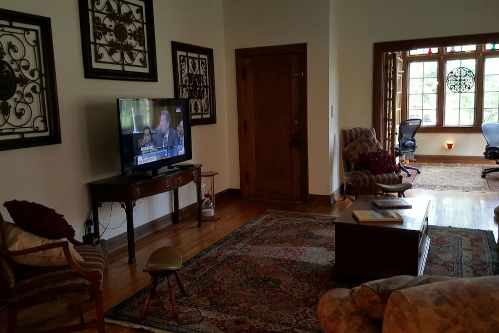 Living room with HD cable TV, looking at front door and office / sunroom.