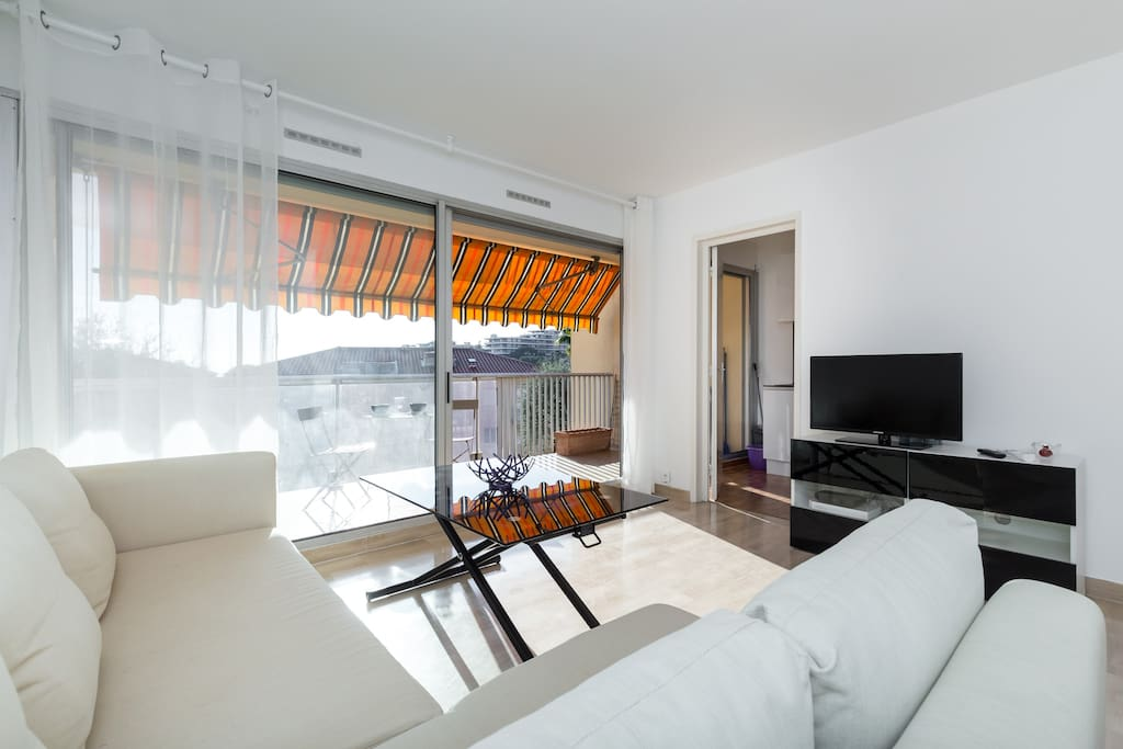 Spacious studio with a flat screen TV.