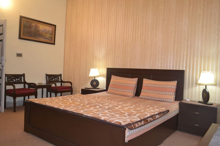 Deluxe King Room with shared Patio