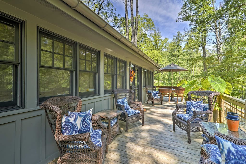 Tune in with the great outdoors on the deck at this unique 22-acre property.