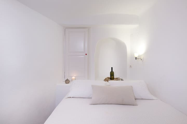 The all white second bedroom.