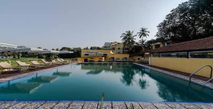 Flat is in heart of Baga with Swimming Pool.