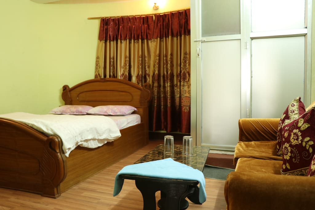 deluxe room with attached bathroom.