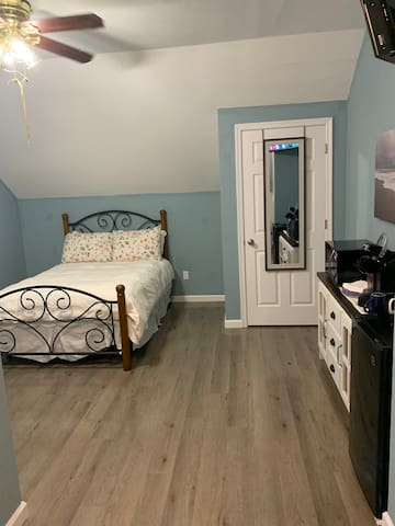 Full size bed. Next to closet. New floors!