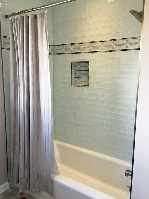 Our private guest bathroom has a stunning, recently updated bathtub and shower combo.