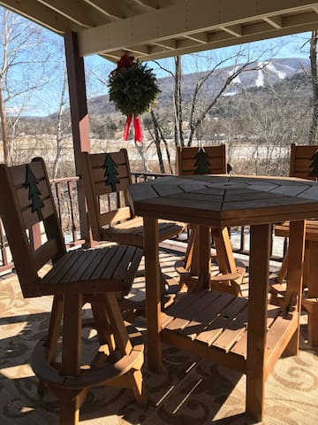 Covered porch next to the Hot Tub with pub-style table & swivel pub chairs. Over-looking the ski slope!