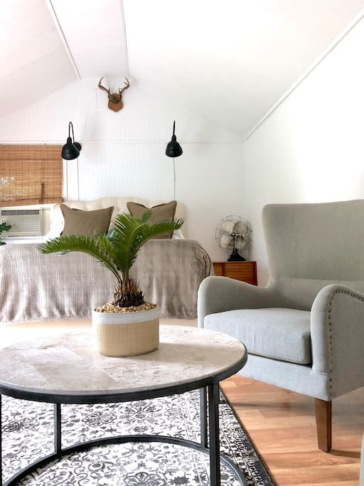 Crisp white modern bungalow With vaulted ceilings,