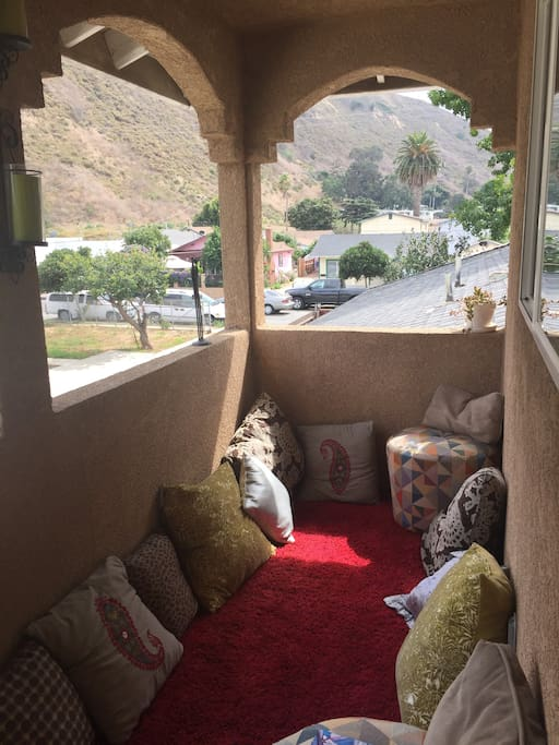 Moroccan style  carpeted balcony with close up mountain views. Great place to take a nap too! :)