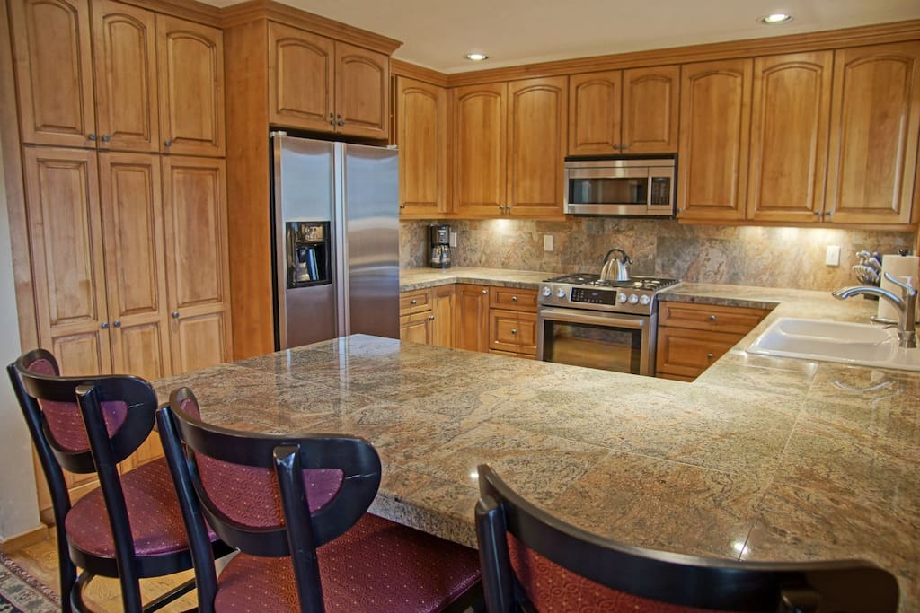 Updated kitchen with granite counters, gas range