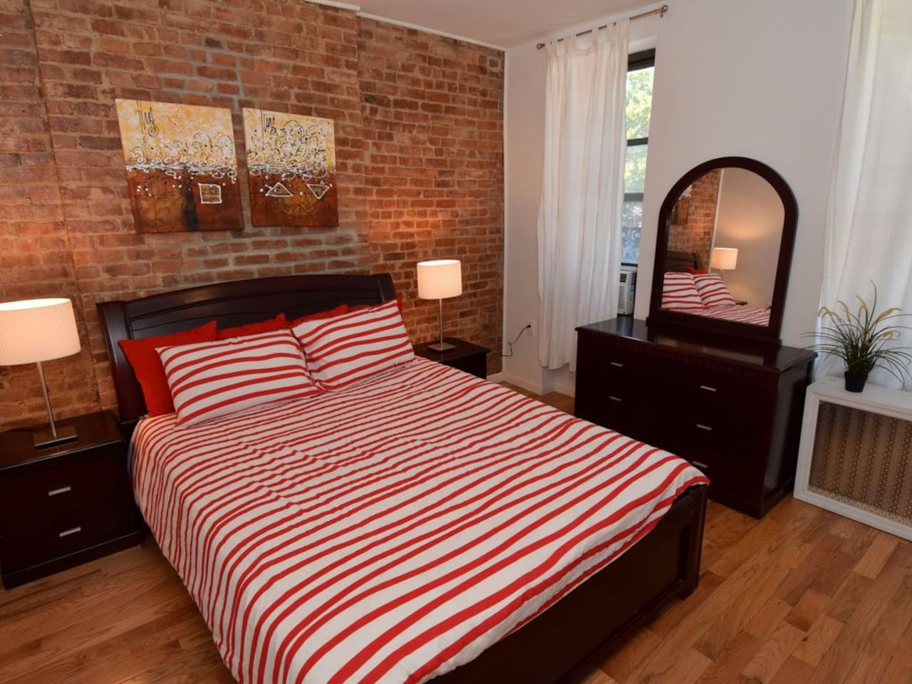 Front bedroom with queen size bed, spacious dresser, and 2 night stands for extra storage.