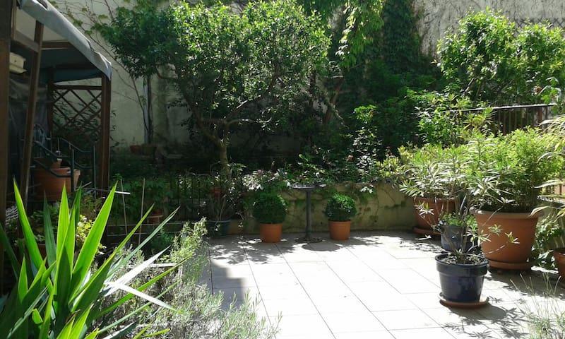 Calme avec jardin privatif