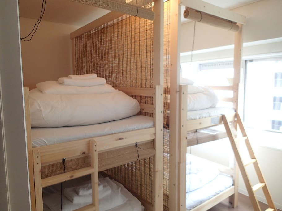 Dormitory room for 4people. we have total 8people can stay these neat and cozy capsule type beds.