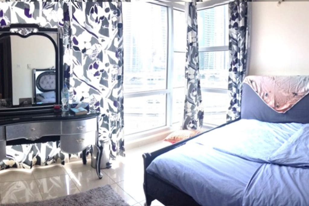 Big double bed. Large windows overlooking Sheik Zayed Road