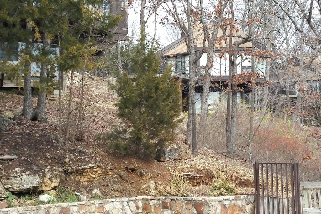 Located in a wooded setting 500 feet from the lake.