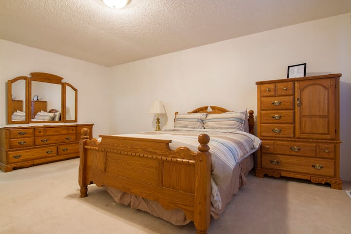 Master Queen Bedroom with high end oak furniture