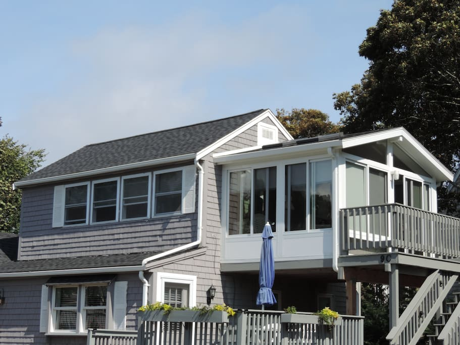 2nd floor cottage condo with ocean views and 3 season room and deck.