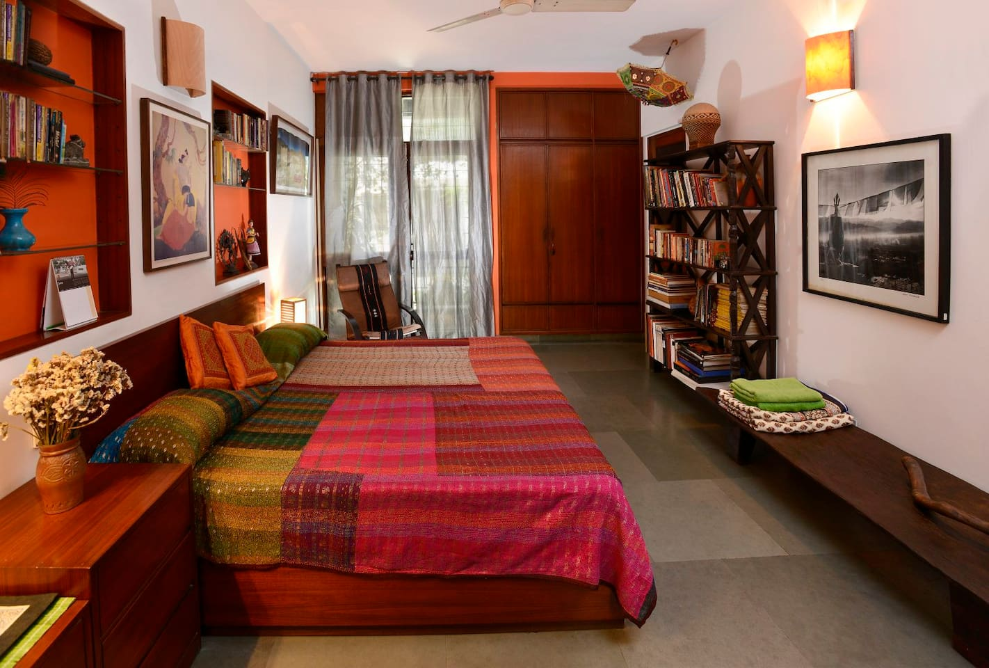 Your spacious bedroom with vivid, handcrafted furnishings and artefacts.