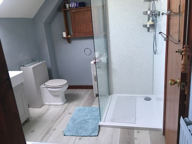 Sumptuous, spacious, newly refurbished en suite bathroom with large power shower and full sized separate bath.
