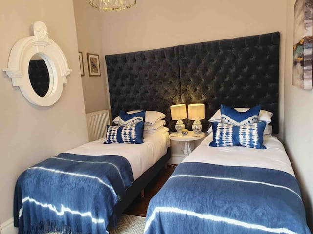 2nd bedroom newly upgraded offering twin beds that can also be a double bed
