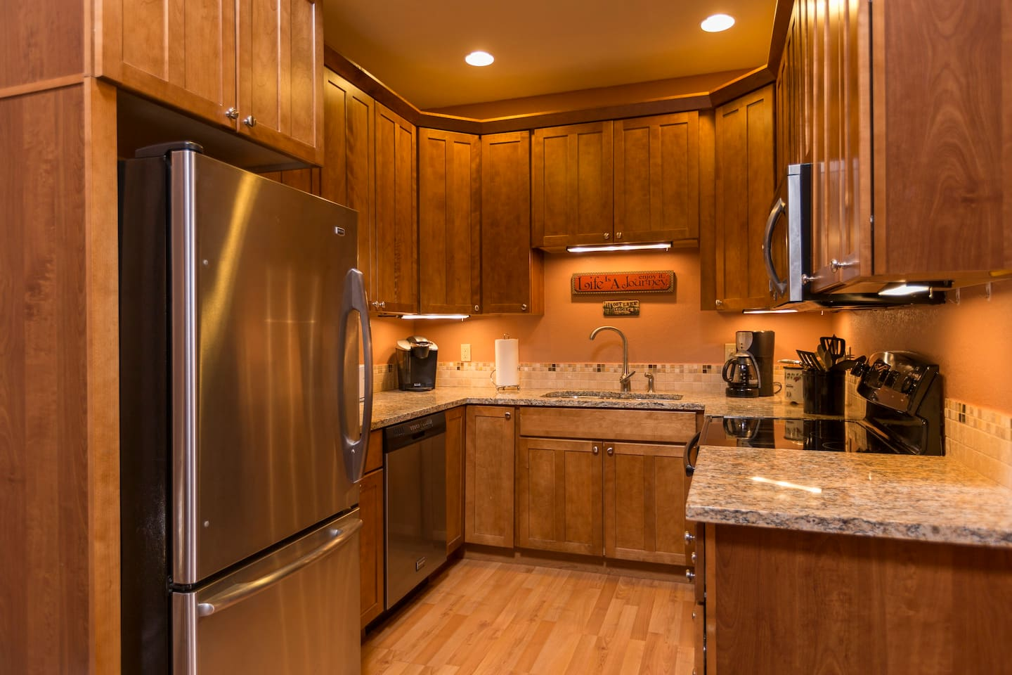 """Completely updated, granite countertop, stainless steel, wood floor, fully stocked """"chef's"""" kitchen. We include many extras like a Breville milk frother (enjoy your cafe au lait, steamed milk drink, or your frothy hot chocolate), croc pot, etc."""