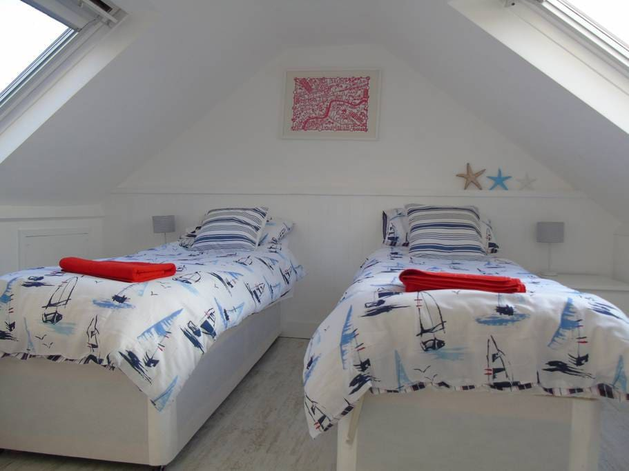 Attic bedroom made up as a twin.