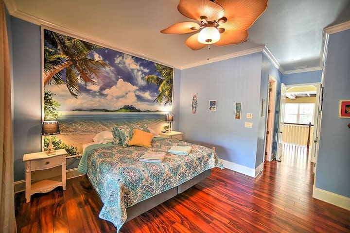 The Beach Room has a king size bed and leads out onto the front upper balcony