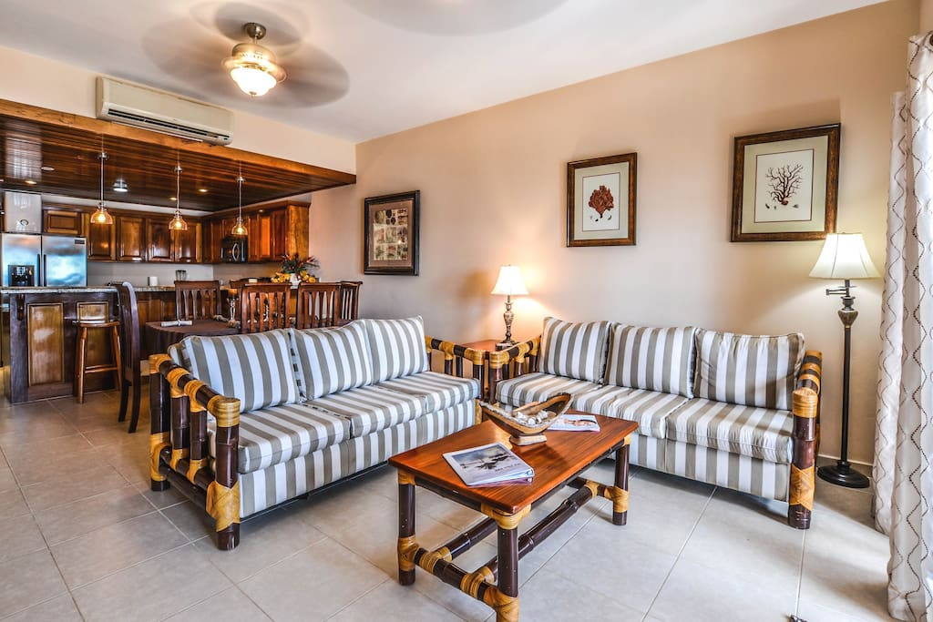Gorgeous living room with French doors leading to your large beachfront balcony!