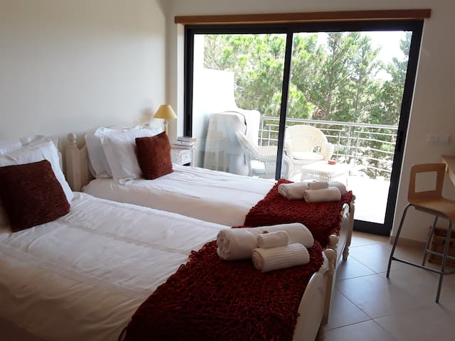 Twin bedroom 1, leading to large shared terrace with bedroom 2
