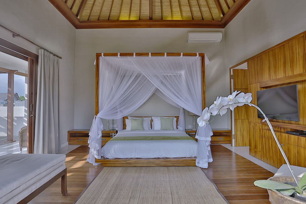 Master bedroom with king bed size completed with outdoor open wooden terrace and private bathroom