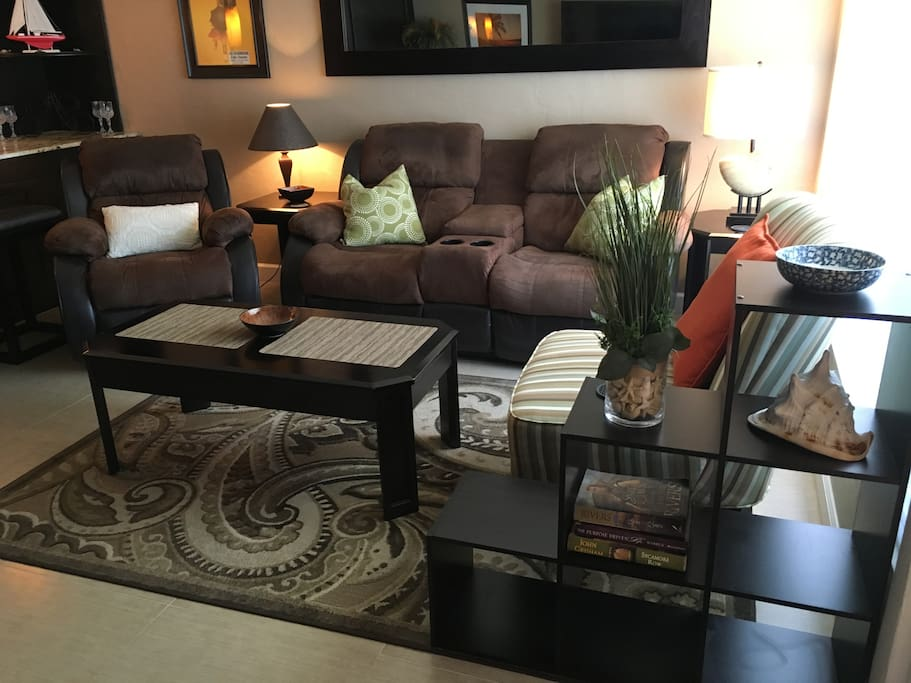 Entryway and living room with 3 large recliner sofa chairs