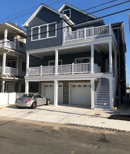 Brand new 2BR apt - steps from the beach