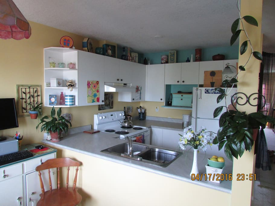 Stocked kitchen and eating area
