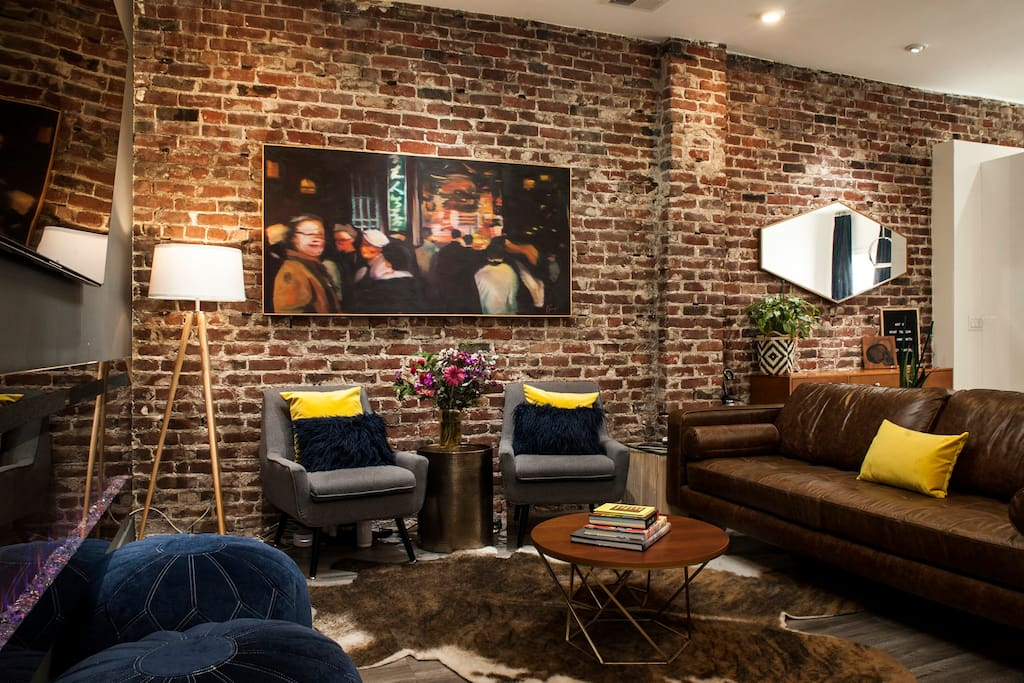 Located above a soon-to-be-opened gallery, guests will enjoy art from local and national names throughout the home.  A variety of styles will rotate on the exposed brick walls from the turn of the century.  (Shown: Manuel Fabregas)