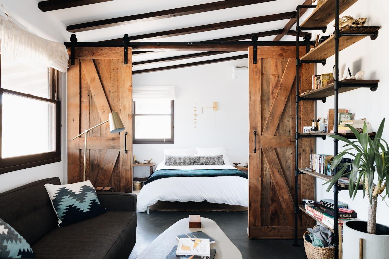 Rustic barn doors open to the bedroom