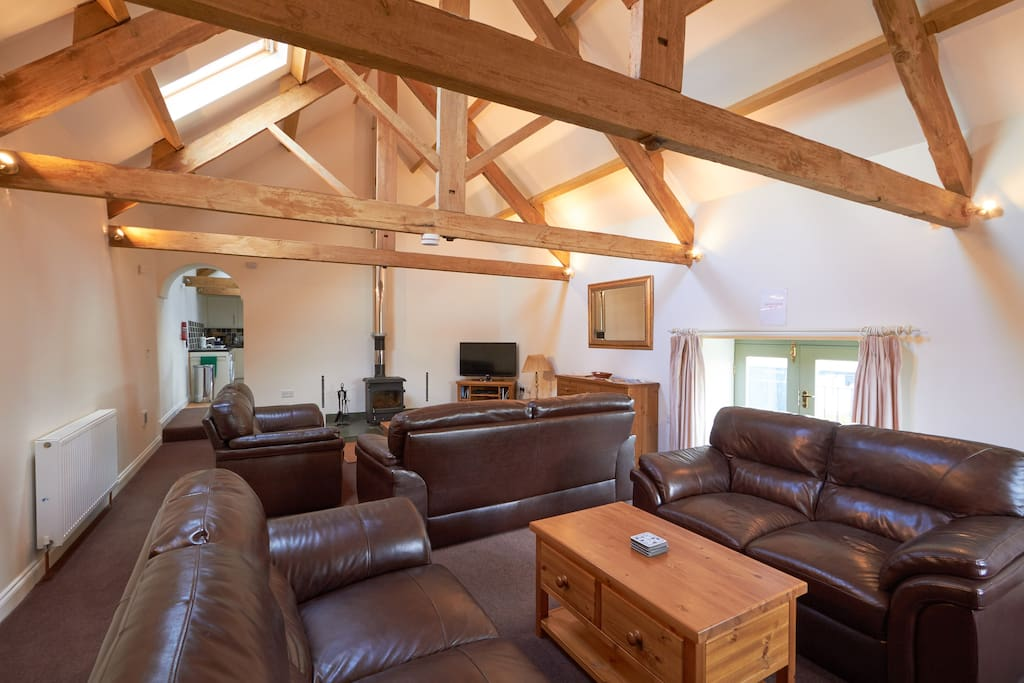 Large living room with wood burning stove
