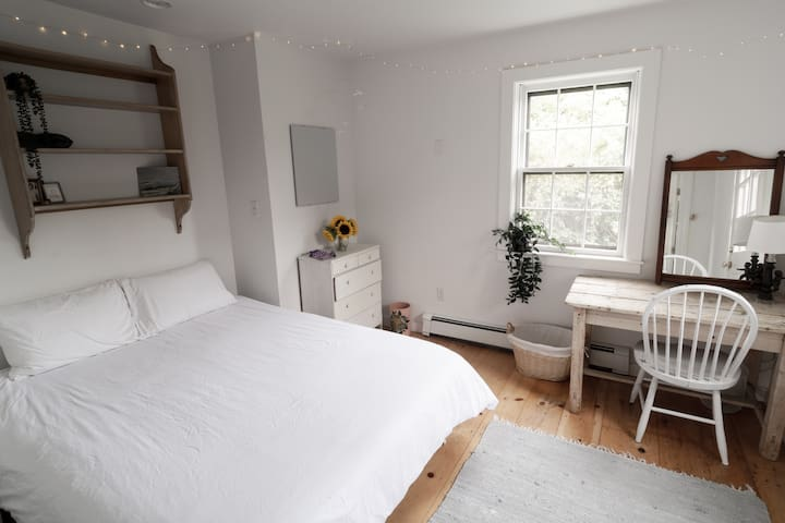 Clean, cheery bedroom in a beautiful Cisco home