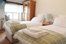 Two en suite bedrooms. One twin, one double.