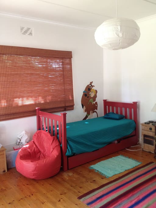 large bedroom with exit to garden