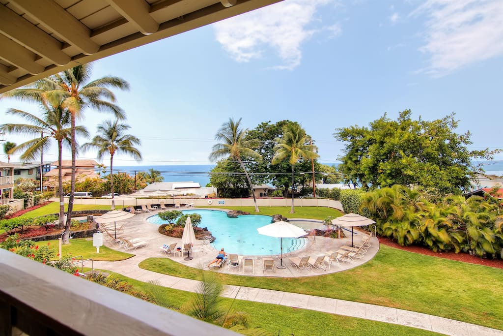 Take in the stunning views of the ocean and complex pool from the unit's private lanai